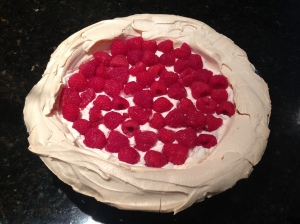 Add whipped cream and fresh raspberries.